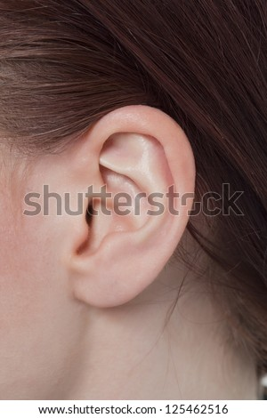 Closed up shot of a woman\'s ear