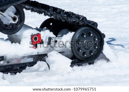 Closed up snowmobile wheels engine #1079965751