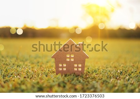 Closed up tiny home model on green grass with sunlight background. Photo stock ©