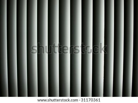 Closed vertical window blinds with sun light shining through make up this abstract image, suitable as a background or wallpaper