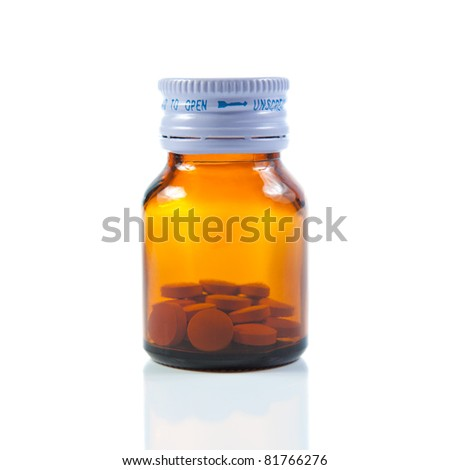 Closed vial of pills. Isolated on white background