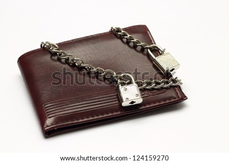 Closed wallet tied with chains