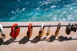 Closed wedding locks - a tradition, many padlocks in the traditional beautiful place of the wedding ceremony in the mountains. Colorful padlocks against the backdrop of the sea and mountains.