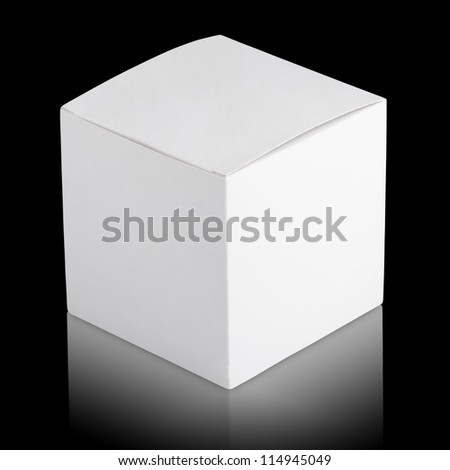 Closed white cardboard box on black background