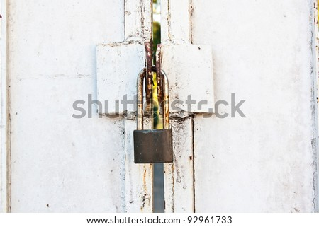 Closed white steel door with metal lock