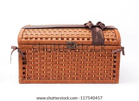 closed wicker chest isolated on white background