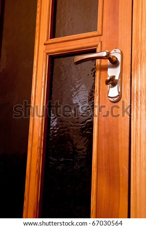 Closed wooden door with silver handle