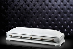 closed wooden white coffin isolated on gray luxury background. casket, sarcophagus on royal background.
