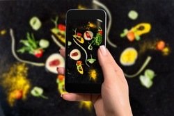 Closely image of female hands holding mobile phone with photo camera mode on the screen abstract gastronomy vanguard concept molecular cuisine