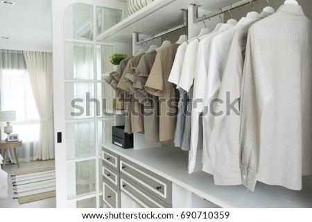 closet with cloth and shelf at home