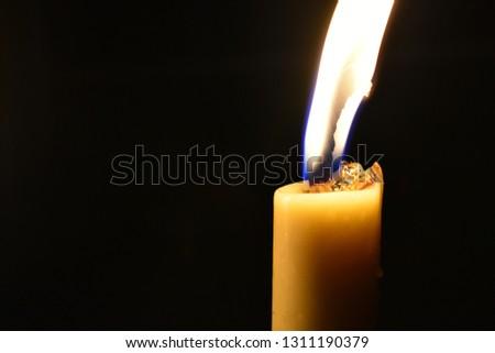 Closeup a candle illuminate in the dark #1311190379