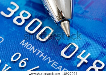 Closeup a credit card and pen