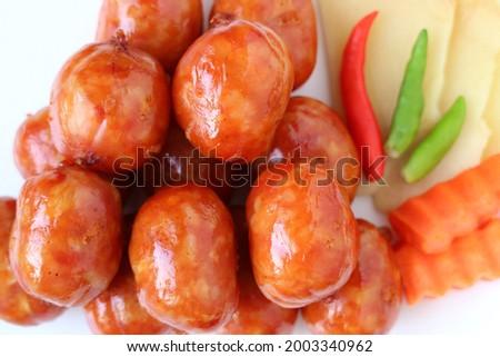 Closeup a Plate of Flavorful Northeastern Thai Sausages Called Sai krok Isan Zdjęcia stock ©