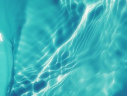 Closeup abstract of surface blue water in the deep sea for background. The pattern of blue water for background. Abstract of surface blue water. Water splashed for background.