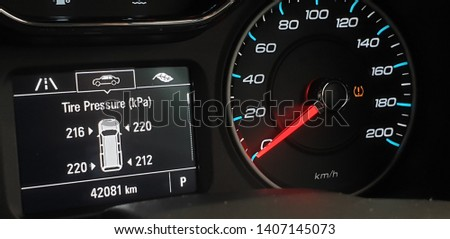 Closeup activated TPMS (Tire Pressure Monitoring System) monitoring display on vehicle cluster, Check tire pressure.