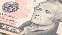 Closeup American money  twenty dollar bill. Alexander Hamilton portrait, US 10 dollar banknote fragment macro.