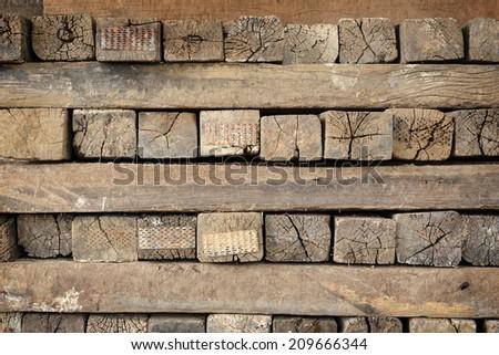 closeup ancient timber stacked, heap of timber
