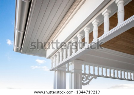 Closeup angled view of PVC millwork, pillars, and woodwork on home residence.