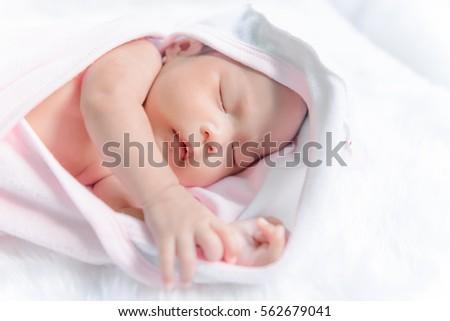 Closeup asian baby Lying on the carpet wool