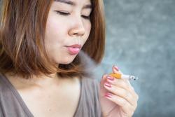 closeup Asian woman smoking cigarette ,unhealthy lifestyle concept