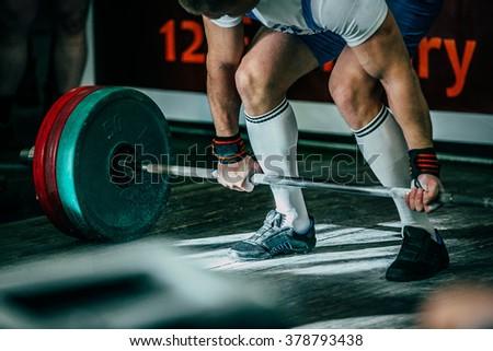 closeup athlete of powerlifter attempt deadlift a heavy barbell