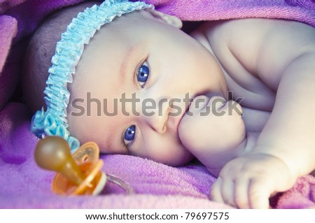 Closeup baby portrait with beautiful blue eyes