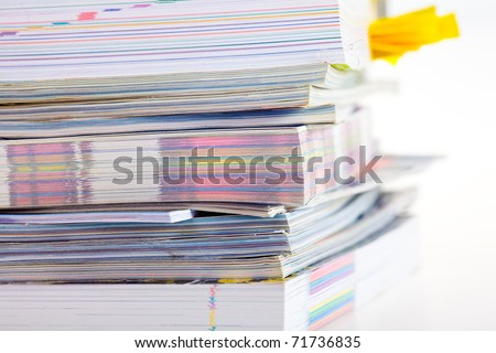 Closeup background of a pile of old magazines