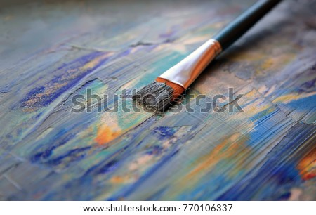 Closeup background of brush and palette. #770106337