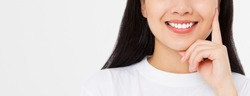 Closeup banner smiling asian woman mouth and white healthy teeth with whitening treatment isolated on white background. Dental women tooth care. Beautiful healthy smile close-up.