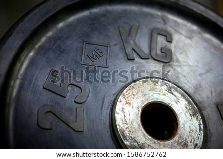Closeup barbell disk 25 kilograms, rubber covered