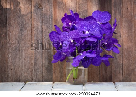 Closeup beautiful bouquet of orchids flower on a wooden background