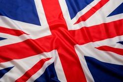Closeup beautifully wavingof UK British flag Union Jack flag background