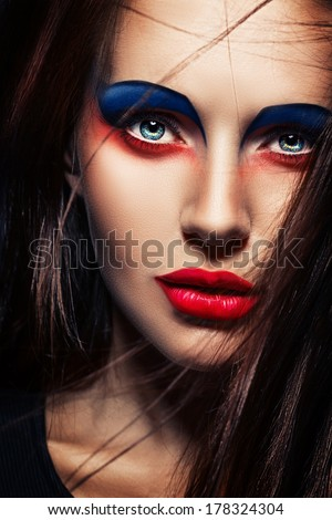 closeup beauty creative red and blue makeup woman face