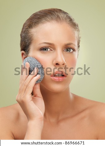 closeup beauty portrait of beautiful funny blonde woman scrubbing her skin