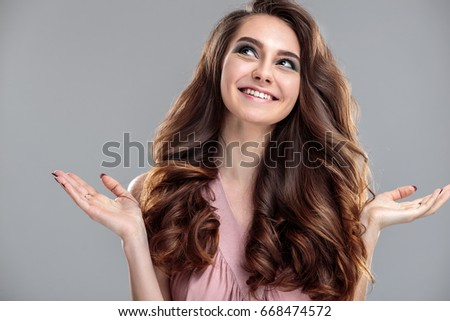 closeup beauty portrait of young woman with natural makeup and hairstyle. spa and care. #668474572