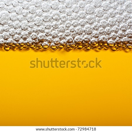 Closeup beer with foam. Macro. - stock photo