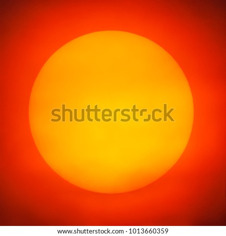 Closeup big yellow sunset on red sky background