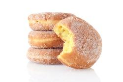closeup bite missing from lemon paczki donut
