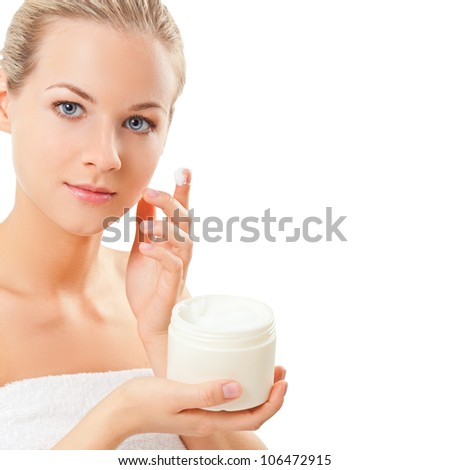 closeup blond woman holding jar with cream over white background, space for the text