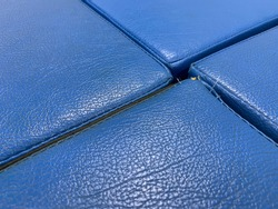 Closeup blue colored leather textured surface. Free space for insert text.