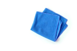 Closeup blue duster microfiber cloth for cleaning isolated on white background . Top view. Flat lay. Clipping path.