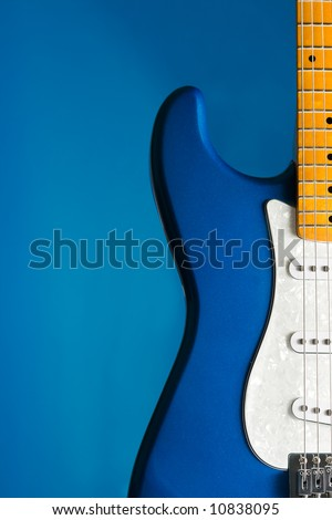 closeup blue electric guitar with blue background