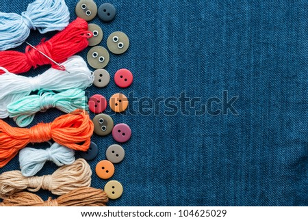 Closeup blue jeans background with different buttons and threed. Space for your text.