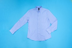 Closeup blue Long sleeve shirt on blue background