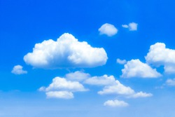 Closeup blue sky and fluffy clouds background
