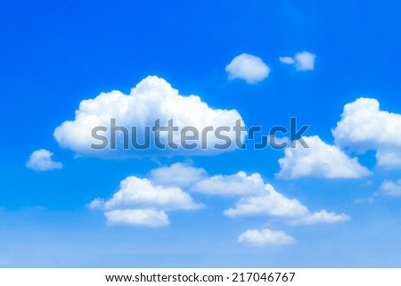 Closeup blue sky and fluffy clouds background - Shutterstock ID 217046767