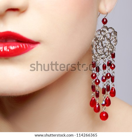 closeup body part portrait of young beautiful woman in jewellery