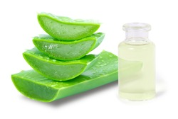 Closeup bottle of aloe vera essential oil extract with aloevera leaf and cut slice isolated on white background. Skin care, health, beauty and spa concept.