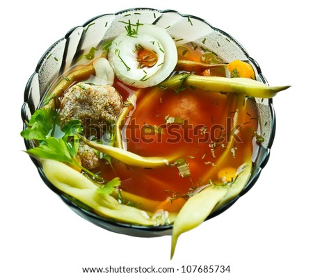 Closeup bowl of haricot soup with teftel isolated on white