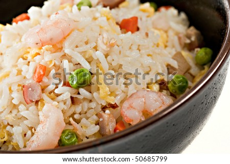 Closeup Bowl of Shrimp Stir Fry Rice, Traditional Chinese Food, Dark Bowl
